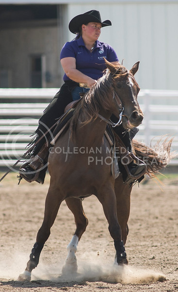 Senior wester rider Jordan Cox competes in the reining part of the meet by having her horse spin in circles on Sept. 8, 2013. The reining competition includes skills such as sliding stops, walking backwards and changing pace smoothly while riding in circles.