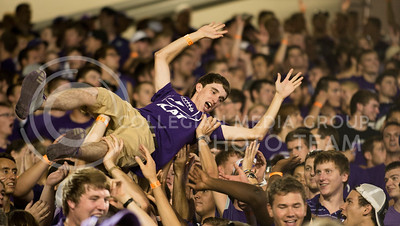 One fan crowd-surfs during the celebration following K-State's first touchdown at the KSU vs NDSU game in BSFS on Aug. 30, 2013.