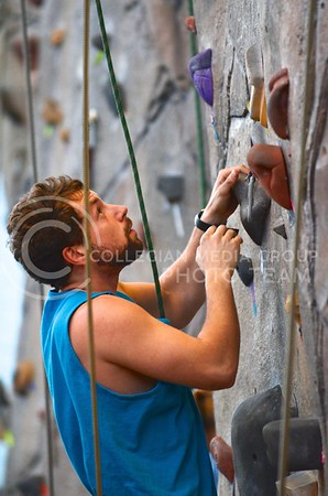 Scott Martin, junior in construction science, looks for his next hand hold with with to hoist himself up the rock face at the Peters Recreation Complex December 17.