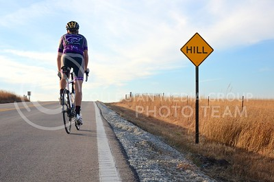 Scott Poelzl, senior in kinesiology, charges up a large hill on Deep Creek Road on his roadbike December 12.