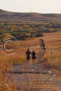 Two K-State students jog through the Konza Prairie on October 12th.