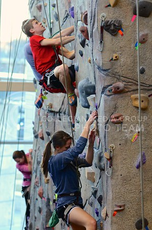 K-State students make their way up the climbing wall during an open climbing period at the rock wall at the Peters Recreation Complex December 17.