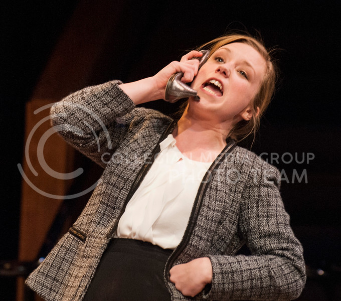 Annete, played by Dani Golway, immitates her husband Alan talking on the phone by speaking in to her shoe.  During the play Alan answers his phone for business repeatedly during a meeting with his wife and the parents of a boy who his son is not getting along with.