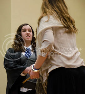 Maureen Barry, sophomore in economics, plays the part of a Slytherin during the first improvization game in which the sorting hat must guess which Hogwarts house the students belong to at the Harry Potter back to school dinner in the Great Room in Hale Library on Saturday.