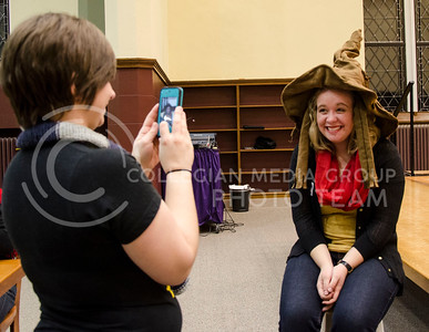 Katie Harrison, sophomore studying secondary education in English, takes a picture on Hannah Abell, sophomore in elementary education, with the sorting hat on her head.