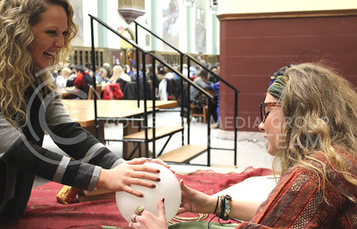 Maile Widman, Junior in Journalism, smiles as she receives good news about her future from the Divination expert, Proffesor Trelawney.  Lyndi Stucky, or Professor Trelawney read peoples fortunes and even predicted that one of the members of the feast will die within the month during last night's Back to School Harry Potter Event in the Great Room.