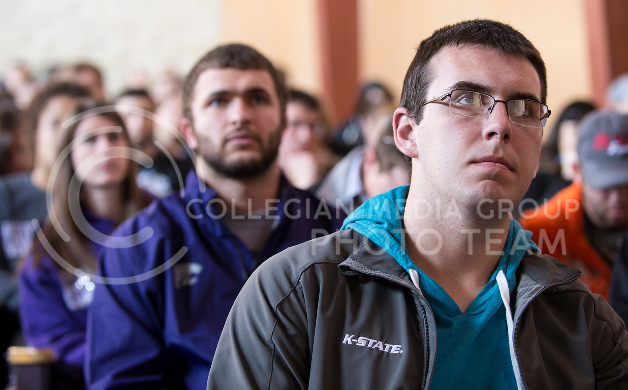 """Mason Carey (right), junior in life sciences, and Evan Loomis, senior in management information systems, listen to the Aretha Franklin's """"I Never Loved A Man (The Way I Loved You)"""" in the History of Rock and Roll in All Faiths Chapel on March 12."""