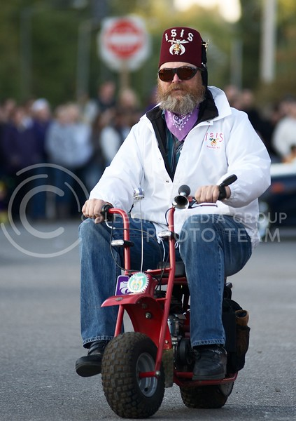 A member of the ISIS Shriners rides through Aggieville during the 2013 Homecoming Parade on October 25.