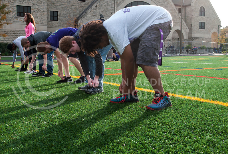 """Homecoming, Crazy Cat Kickoff, the remaining participants of the """"Willie Says"""" competition race to untie their shoes. OCt. 20. Memorial Stadium."""