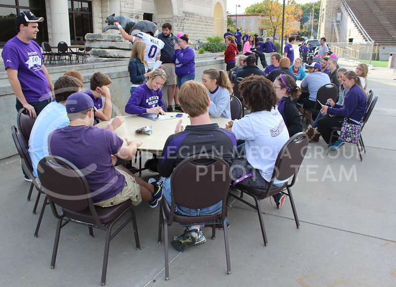 Students are grouped by dorm and compete in Crazy Cat Trivia.