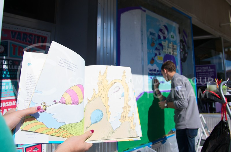 Chase Flanders, freshman in advertising and a member of Sigma Alpha Epsilon, brushes in some text for his groups Dr. Seuss themed painting during Pain the 'Ville on Tuesday.