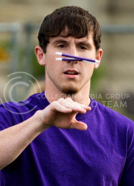 Derek Lingo, sophomore in electrical engineering, attempts to catch pens bounced off the back of his hand during the Crazy Cat Kickoff in Memorial Stadium. Crazy Cat Kickoff was a series of silly games for teams residence hall students; Lingo was part of the Goodnow Hall team.