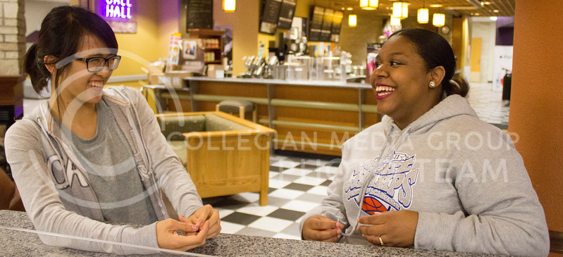 Tran Pham, a sophomore in mechanical engineering, shares a laugh with Brianna Chatmon, a sophomore in open option, at the Student Union on Oct. 8.<br /> <br /> The International Buddies program is desiged to help bring international students and domestic students together.