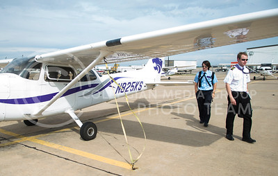 Cameron Beeler, a freshman in professional piloting, and his instructor James Schreiner, a senior in professional piloting, walk away from their plane after a successful flight Wednesday morning at K-State Salina.  Beeler practiced power on stalls for the first time and said it was very exciting.