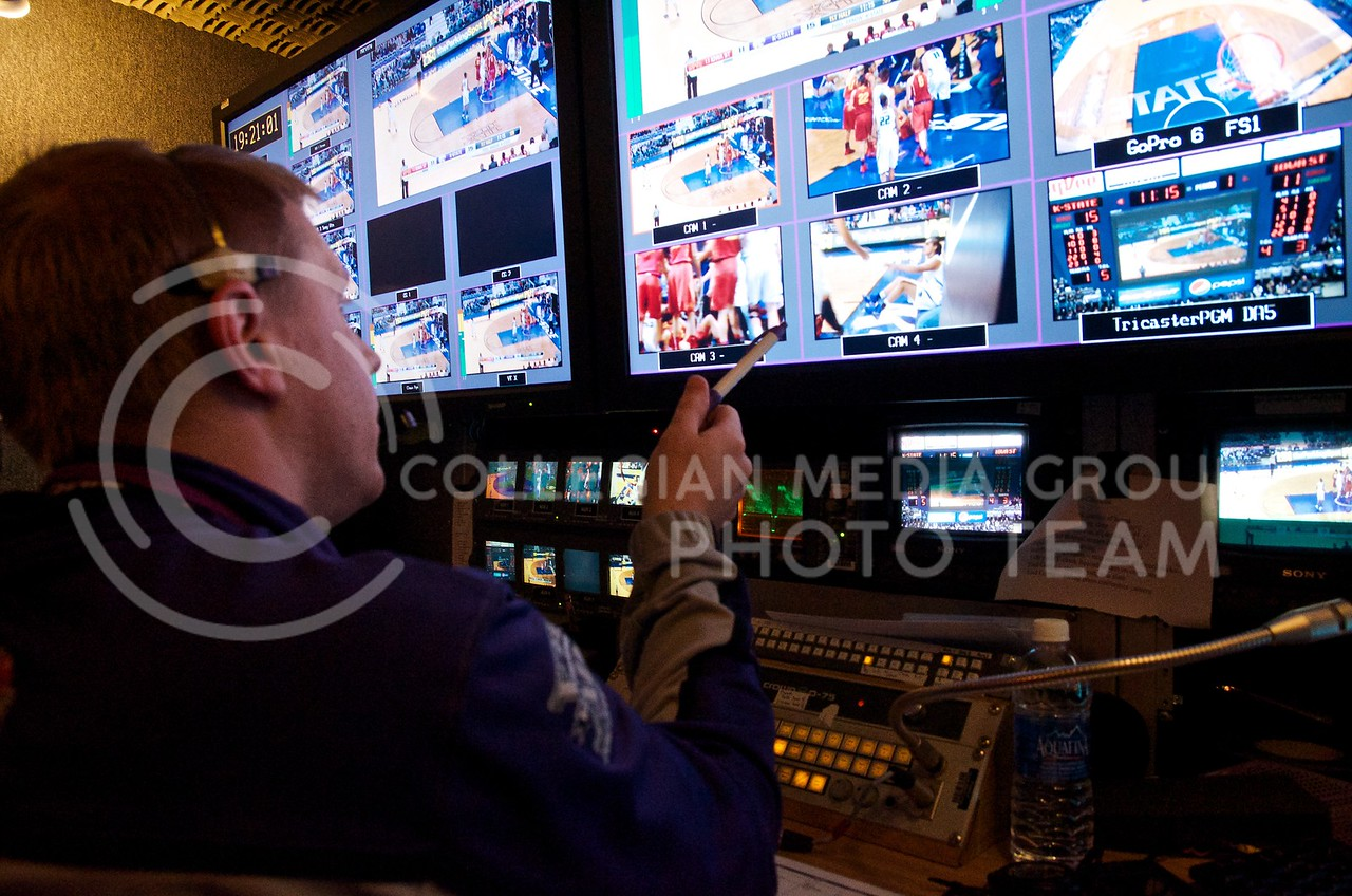Andy Liebsch, Assistant Director of K-StateHD.TV, and broadcast production director on gameday, points out one of the camera feeds as he directs the K-StateHD.TV crew from the broadcast production truck during the women's basketball game against Iowa State January 18.