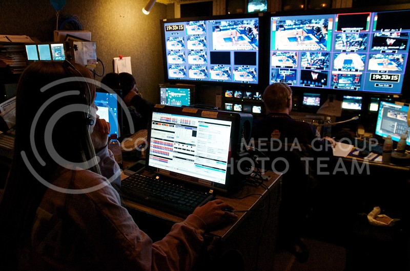 In one end of the cramped production truck, the K-StateHD.TV crew weaves together any of a number of live and stored video sources, adds appropriate stats and graphics, and sends it out for K-StateHD.TV subscribers around the world to view live.
