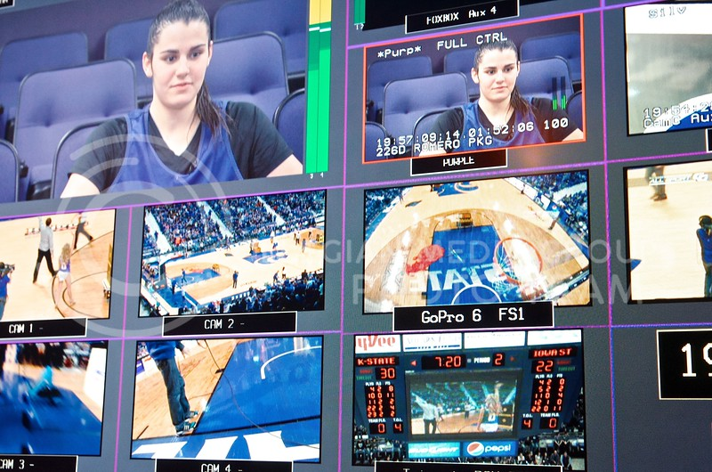 One wall of the broadcast production truck is covered in a giant screen displaying all the camera and video sources between which director Andy Liebsch can switch, as well as what is currently broadcasting in the upper left. During halftime of the women's basketball game against Iowa State, a video spot on freshman guard Leti Romero plays for K-StateHD.TV viewers, while a magic show happens mid-court for attendees of the game.