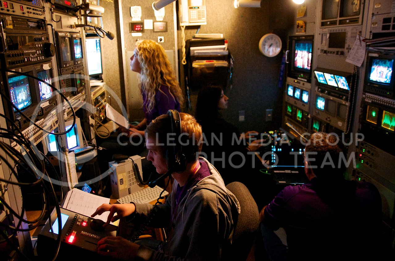 Between people and powerful video equipment, space is extremely limited inside the K-StateHD.TV production truck during a broadcast.
