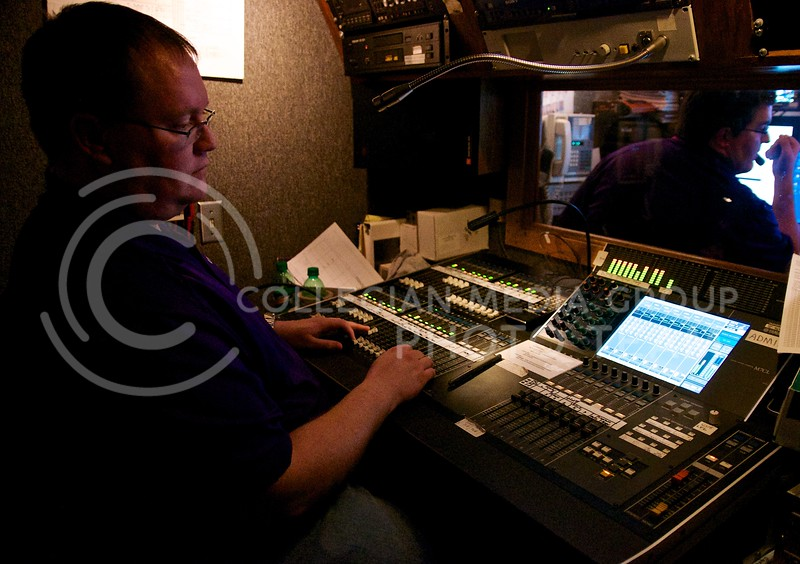 Brandon Utech mixes the audio for the women's basketball game broadcast in the tiny sound booth in the production truck parked on the south side of Bramlage.