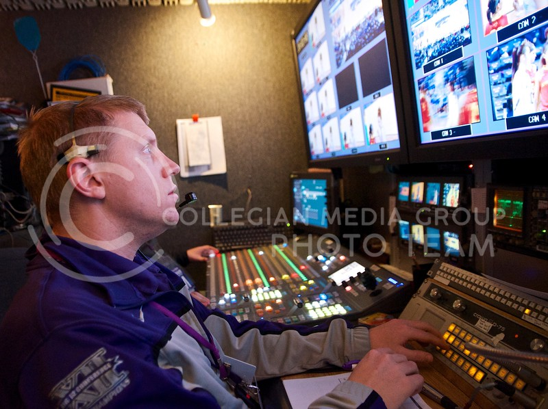 Director Andy Liebsch directs his cameramen to the shots he wants during the women's basketball game against Iowa State.