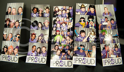 Snapshots from other groups that visited the K-State Proud photo booth are displayed at the K-State Proud table in the Union on Feb. 25.