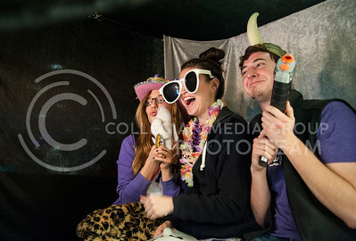 from left: Lauren Osborn, freshman in interior design, Melody Schoneboom, junior in interior design, and Tyrell Sandoval, junior in internior design, pose with props at the K-State Proud photo booth in the Union on Feb. 25.