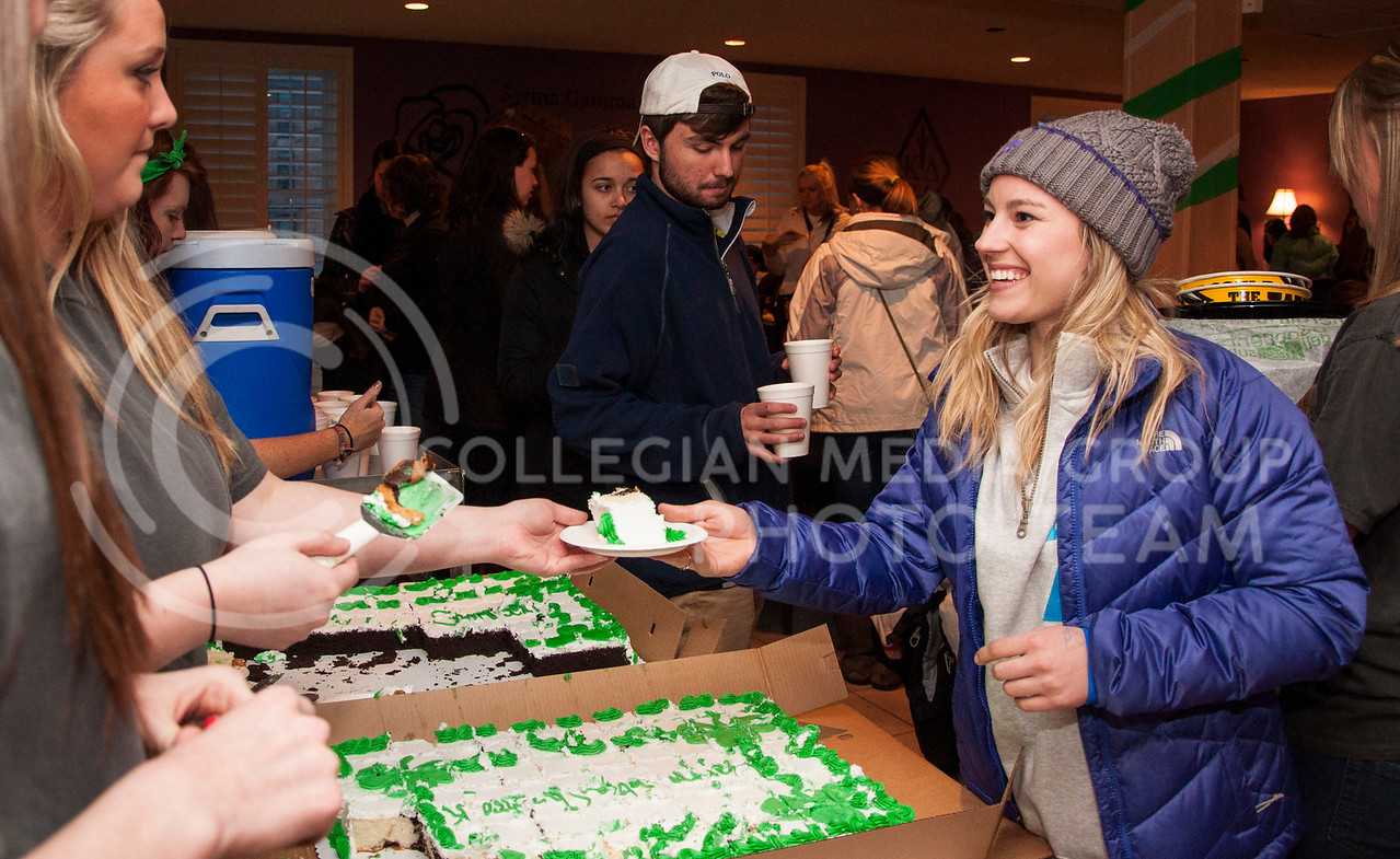 Rachel Walker, freshman in chemical engineering, gets a piece of cake to go with her dinner at the Shamrock Shootout at the Kappa Delta house on March 2.