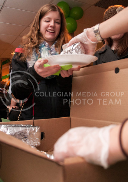 Ella Magerl, freshman in park management and conservation, receives a burrito from a server at the Kapp Delta Shamrock Shootout buffet dinner at the Kappa Delta on March 2.
