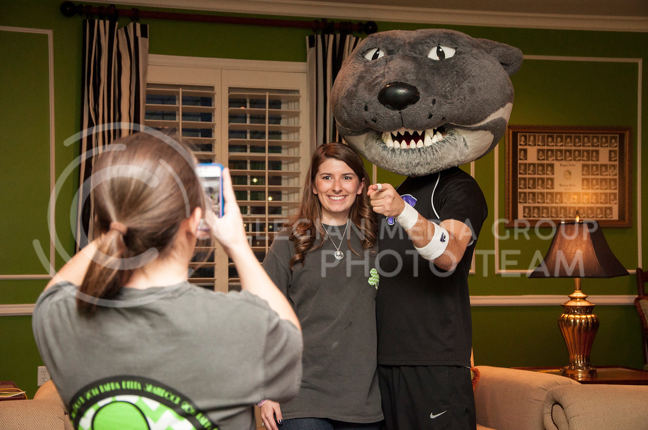 Willie the Wildcat poses with the president of Kappa Delta at the Shamrock buffet dinner in the Kappa Delta house on March 2.