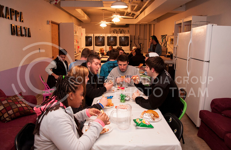 So many people attened the Kappa Delta Shamrock Shooutout buffet dinner that extra seating had to be provided in the laundry room of the sorority house on March 2.