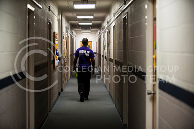 """On April 11, as part of being """"on duty"""" as an RA, Phil Hill, sophomore in marketing, walks all the halls in West Hall to check the facilities and make sure everything is in order."""