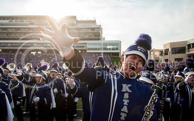 Photo by Hannah Hunsinger | Royal Purple  Owen Moore, sophomore in food science, shows his Wildcat pride at the pregame pep band before the K-State vs. UMass football game on Saturday, Sept. 14 in Bill Snyder Family Stadium.