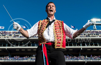 Photo by Hannah Hunsinger | The Collegian Assistant  drum major, Brett Eichman, senior in music education, conducts during the Les Miserables halftime show at the football game against West Virginia, on Oct. 26, in Bill Snyder Family Stadium.