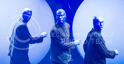 Blueman Group members look to the audience in confusion as six large balls are placed on stage at McCain Wednesday night.