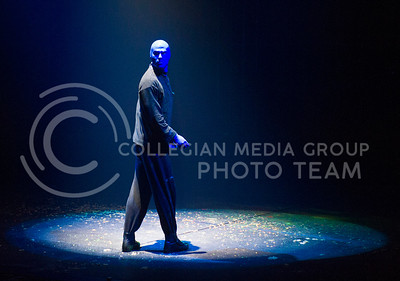 Lit up by a spotlight Wednesday night, a member of the Blueman Group listens to an automated voice give instructions.