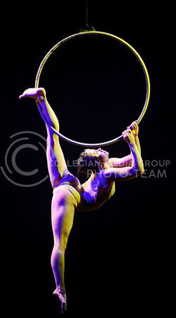 A performer synchronizes her body with the electronic music and a spinning ring suspended high in the air as she performs choreographed acrobatics during Quixotic's performance Friday evening in McCain Auditoium.