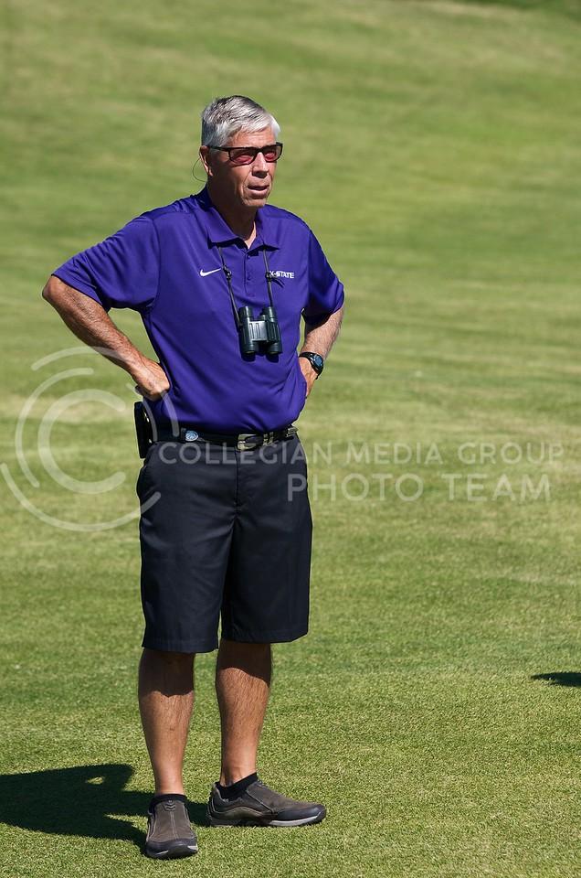K-State men's golf head coach Tim Norris watches David Klaudt hit a tee shot during the Jim Colbert Intercollegiate at Colbert Hills Golf Club in Manhattan, Kansas on  October 1, 2013.