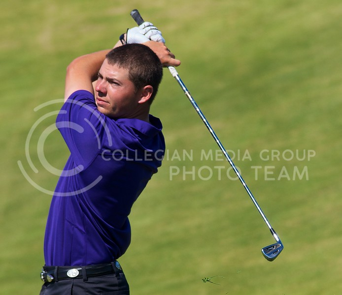 K-State senior Tyler Norris watches the ball after his tee shot during the second day of the Jim Colbert Intercollegiate at Colbert Hills Golf Club in Manhattan, Kansas on  October 1, 2013.