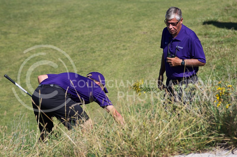 K-State men's golf head coach Tim Norris helps Kyle Weldon look for the ball after his tee shot went past the green and landed in the tall grass during the Jim Colbert Intercollegiate at Colbert Hills Golf Club in Manhattan, Kansas on  October 1, 2013.