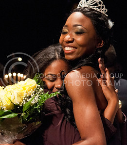 Chandrika Brewton, newly crowned Miss Black and Gold, is embraced by a sorority sister.