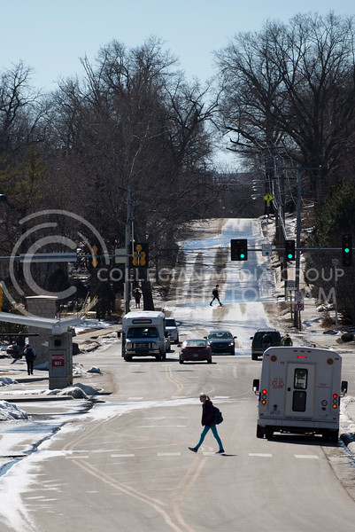 After disembarking from the ATA bus a student crosses 17th street on Feb. 17.