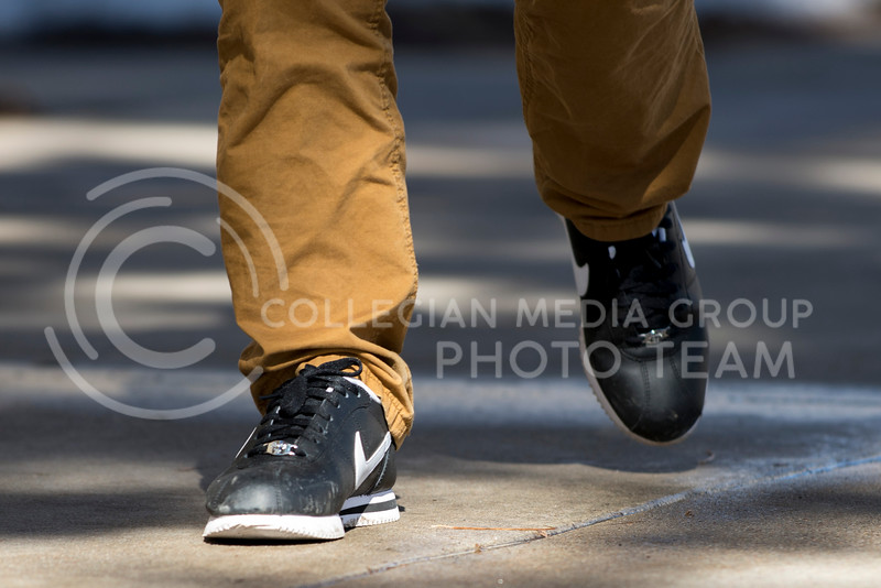 A student's shoes as he walks across campus on Feb. 17.