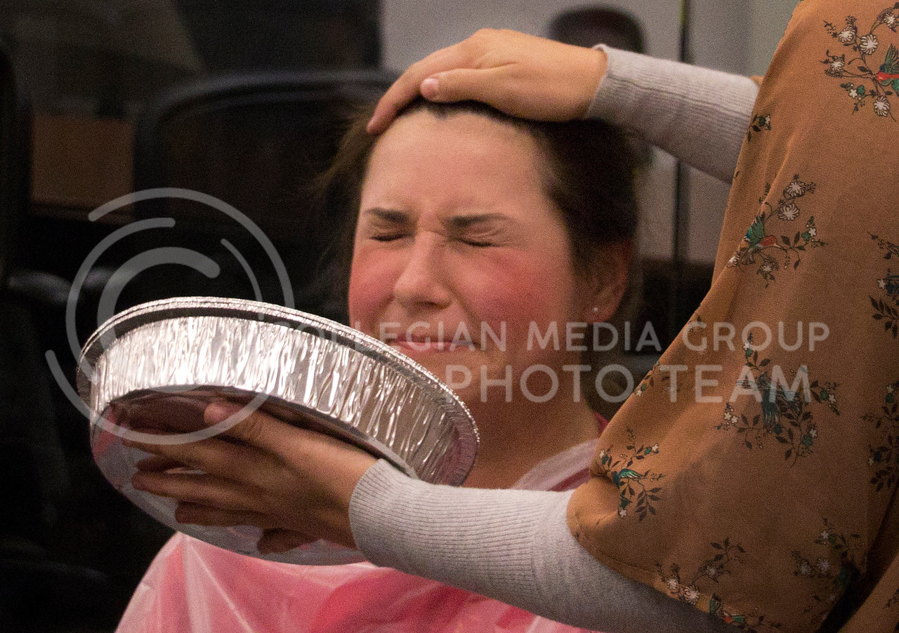 Connie Beck, senior in family studies, closes her eyes in anticipation of getting a pie in her face at the Pie Crawl in Ford Hall on Monday, Nov. 18. The procedes benefited K-State policeman, Sergeant Brian Sheaves and his wife who has cancer.
