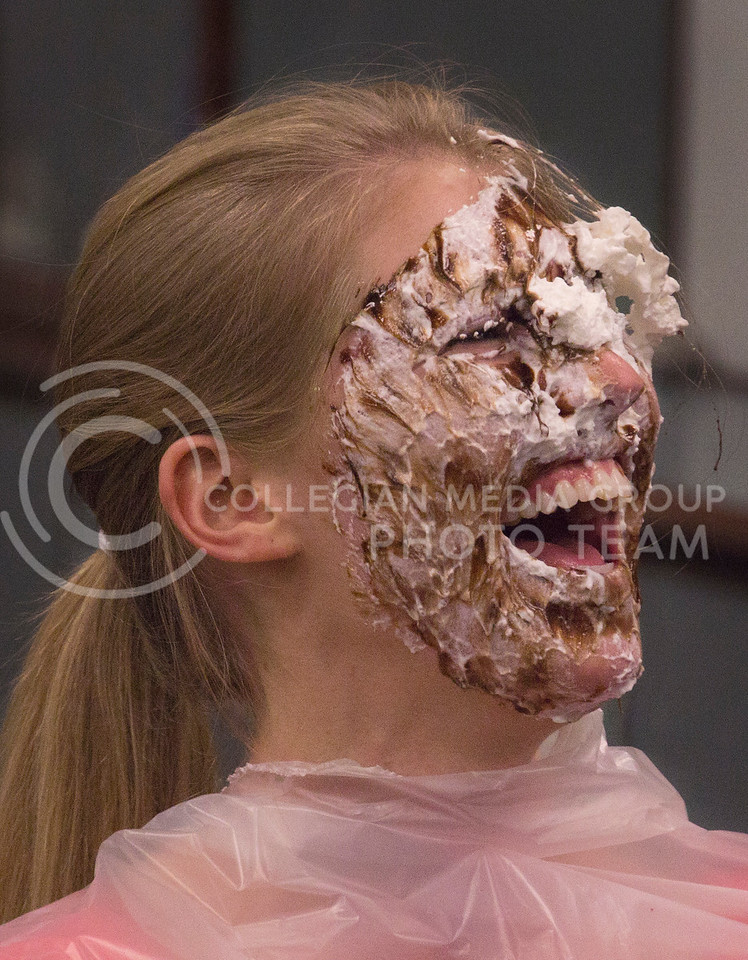 Annie Hanson, senior in studio art and psychology, reacting after getting a pie in the face at the Pie Crawl in Ford Hall on Monday, Nov. 18. The procedes benefited K-State policeman, Sergeant Brian Sheaves and his wife who has cancer.