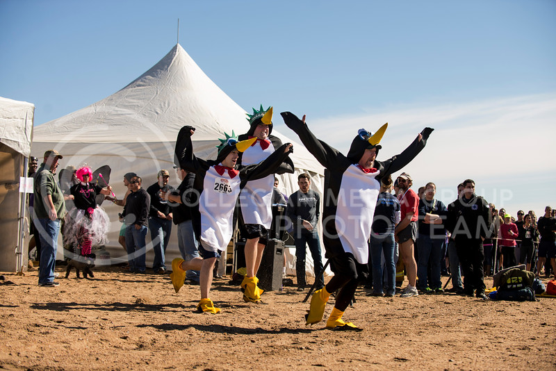 """The Penguins"" charge down the beach as the first particpants in this years Polar Plunge on Feb. 22 at Tuttle Creek State park."