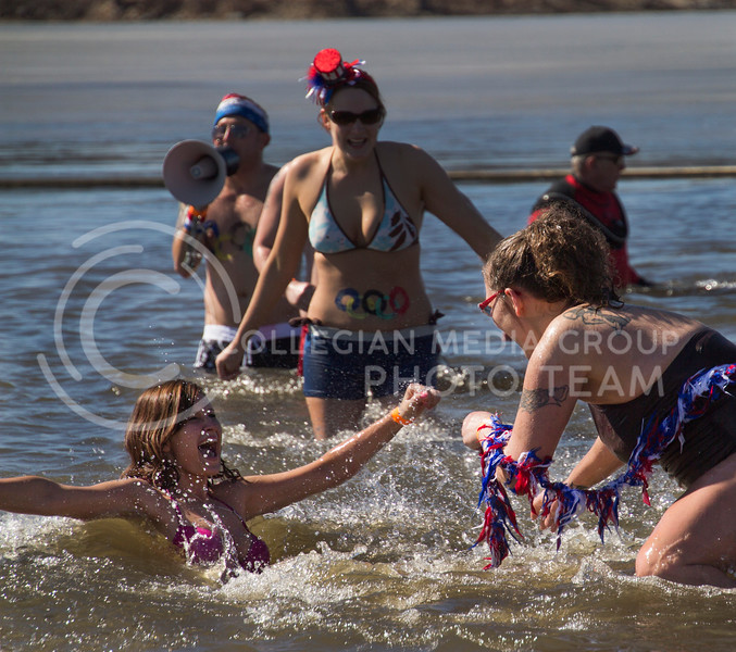 A group celebrates after running into Tuttle Creek during the Polar Plunge. The event was held on Saturday to raise money to benefit the Special Olympics.