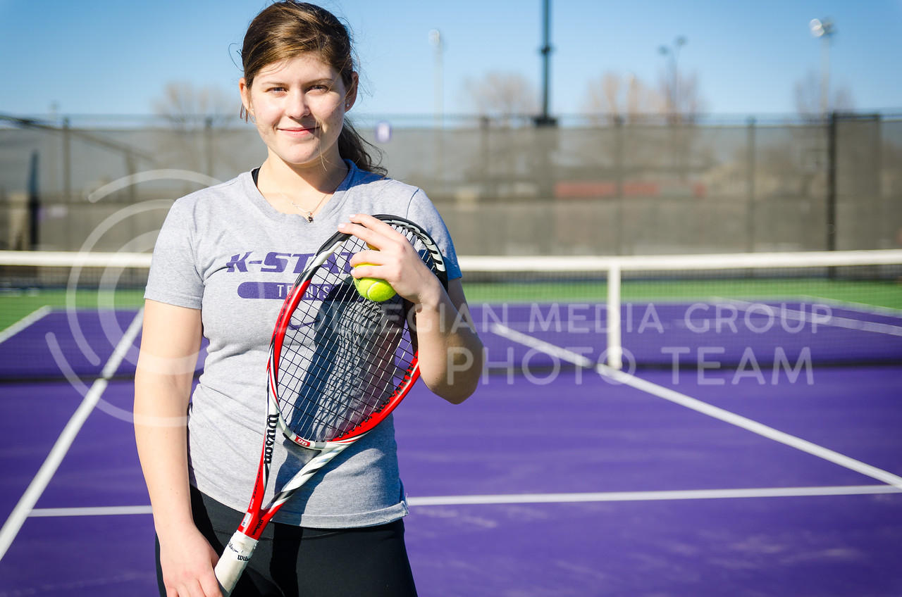 Freshman tennis player Livia Cirnu, from Constanta, Romania, stands on one of the courts of the new Mike Goss Tennis Stadium during the team's first outdoor practice on a very nice day February 18, 2014.