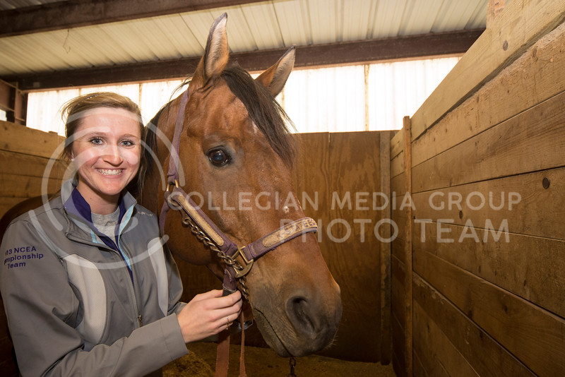 Libby Tudor poses with Howard in the K-State stables on Feb. 20.