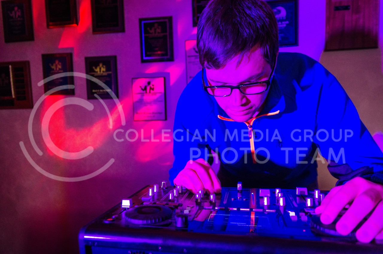 """Alan """"AJ"""" Davis, a DJ with Complete We Do in Manhattan, spends most of his Friday and Saturday nights DJing at various events. According to Davis, a DJ has to feel out the crowd, but sometimes it's ok to get a little weird."""