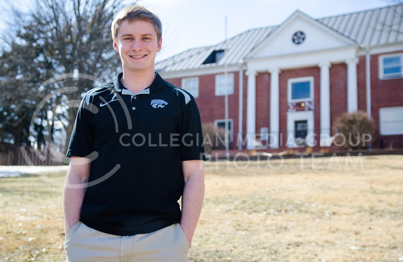 Ben Rhinehart, junior in kinesiology, stands on the sloping lawn in front of Sigma Nu fraternity March 4, 2014.